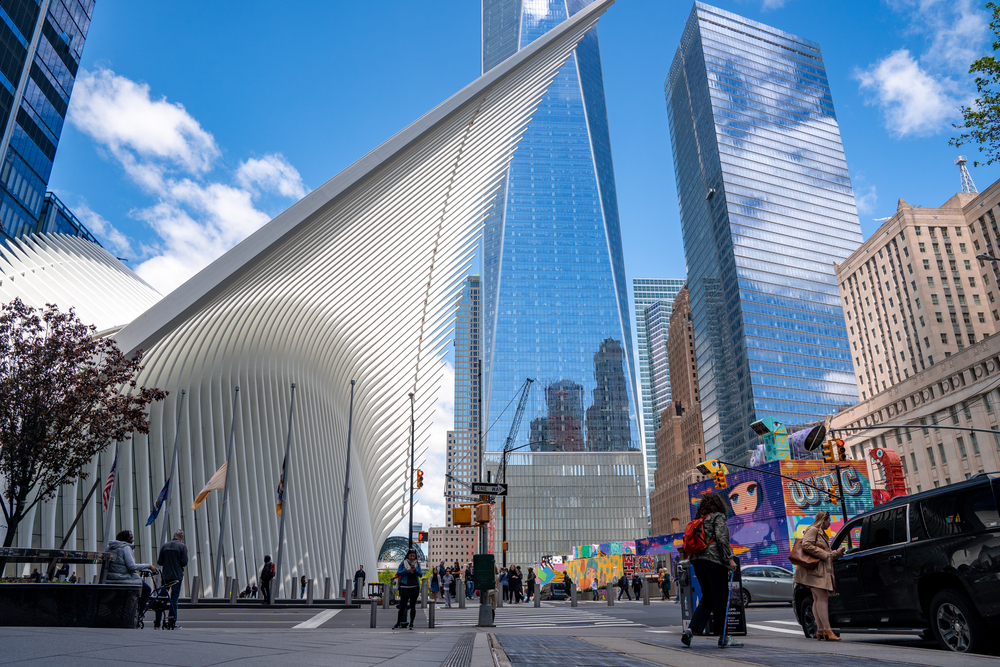 Walking outside One World Trade Center near the entrance to the Oculus transportation hub.